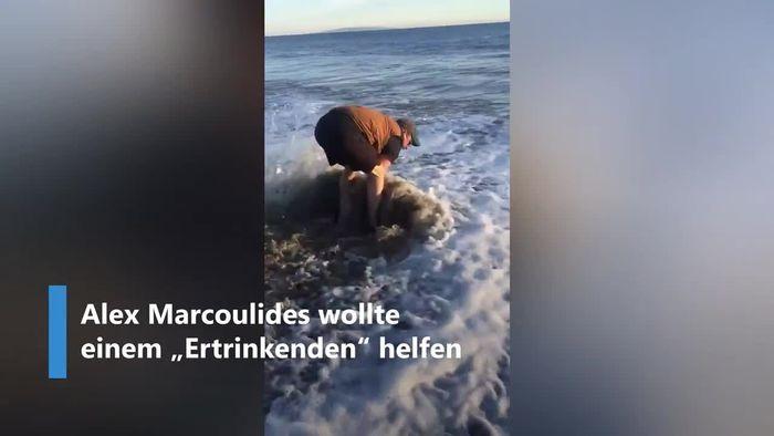"""Mann eilt """"Ertrinkendem"""" zu Hilfe und rettet Baby-Delfin"""