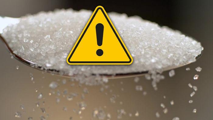 Zu viel Zucker ist ungesund. Unser Körper reagiert darauf mit verschiedenen Warnzeichen.